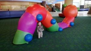 At his beloved caterpillar :)